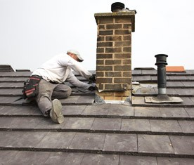 Roofer working on a chimney